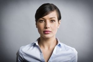 Headshot of Women with Serious Expression
