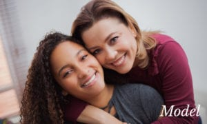 Mom and Teenage Daughter Smiling and Hugging