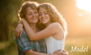 Mother and Daughter Embracing Under The Sunlight