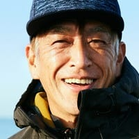 Smiling Mature Male in Blue Hat and Jacket