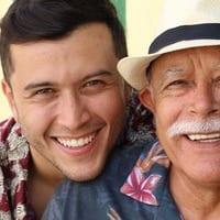 Young Man & Grandfather Smiling Together