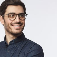 Young Smiling Male in Black Glasses and Dress Shirt