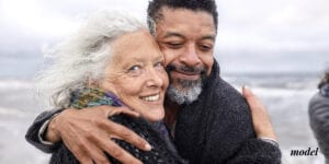 Older Smiling Couple Embracing at the Beach